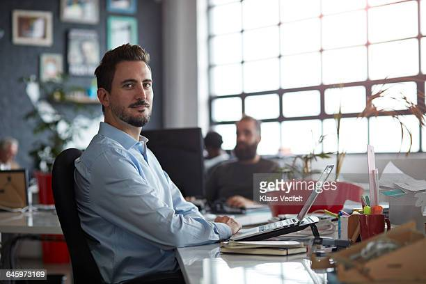 portrait of creative businessman at his desk - differential focus stock pictures, royalty-free photos & images