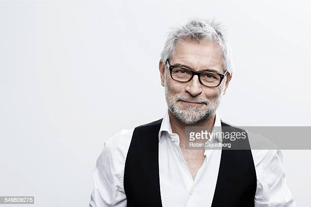 portrait of creative man with glasses - one mature man only stock pictures, royalty-free photos & images