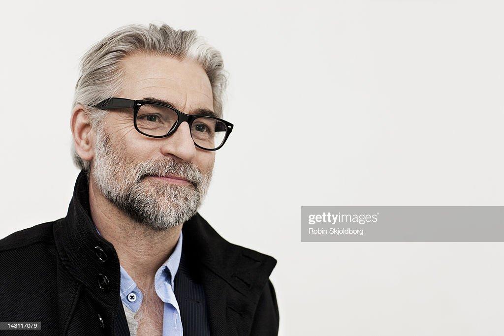 Portrait of creative mature man with glasses : Foto de stock