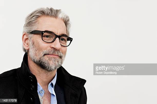 Portrait of creative mature man with glasses