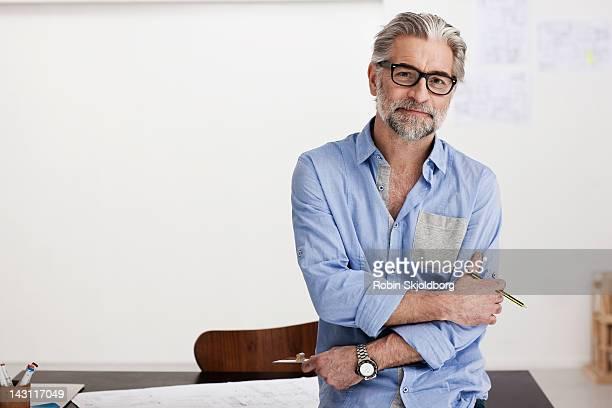 portrait of creative mature man working on sketch - homem 45 anos imagens e fotografias de stock