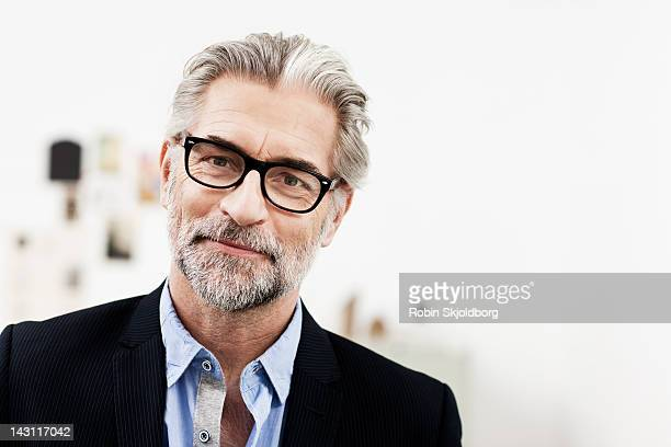 Portrait of creative mature modern business man