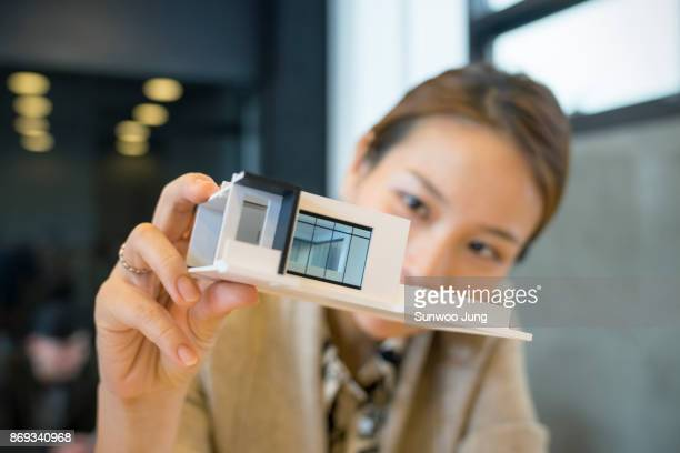 portrait of creative professional holding architectural model - asian model stock photos and pictures