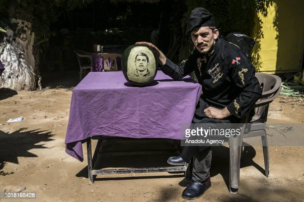 A portrait of Cristiano Ronaldo carved on a watermelon by cook Halil Bozkurt is seen in Turkey's Hatay on August 17 2018 Bozkurt carves portraits of...