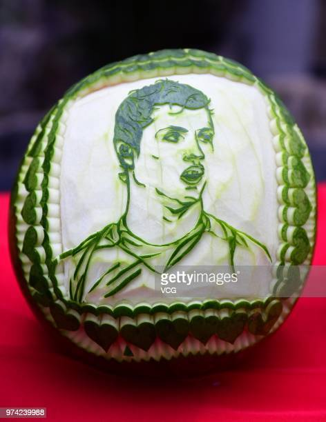 A portrait of Cristiano Ronaldo is carved on a watermelon at Shenyang Foreign Affairs Service School ahead of the FIFA World Cup on June 14 2018 in...