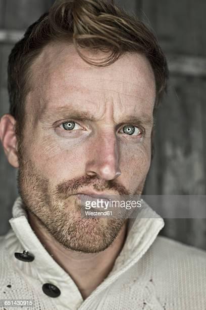 Portrait of critical man