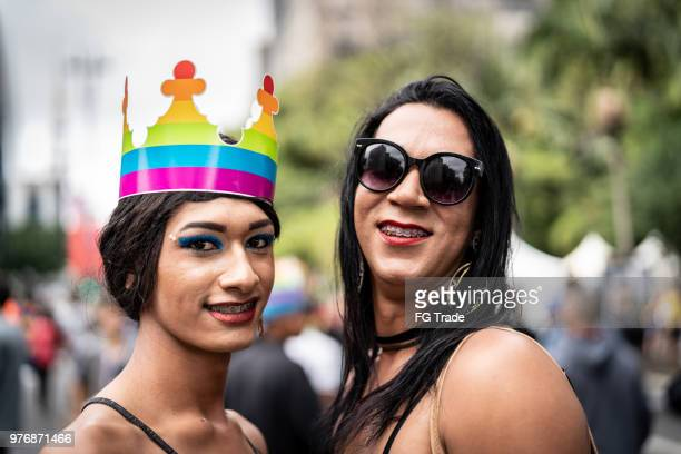 portrait of cross dressing friends in gay pride parade - ladyboys stock pictures, royalty-free photos & images