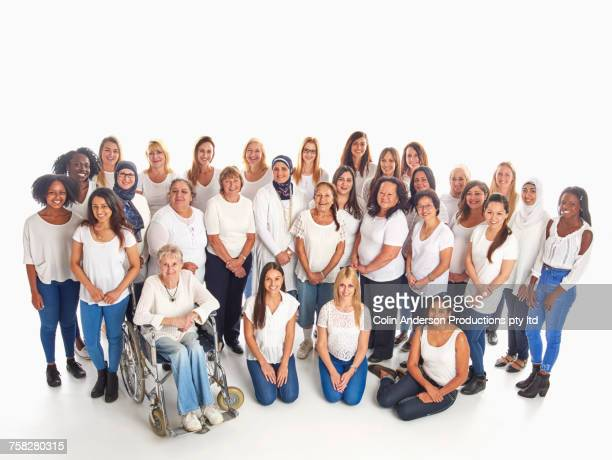 Portrait of crowd of diverse smiling women