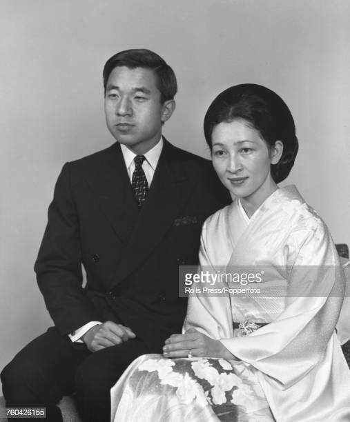 Portrait of Crown Prince Akihito and Crown Princess Michiko posed together wearing a suit and kimono in Japan in October 1971
