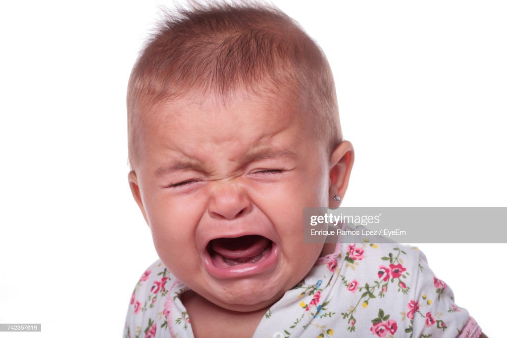 Portrait Of Crying Baby Against White Background : Stock Photo