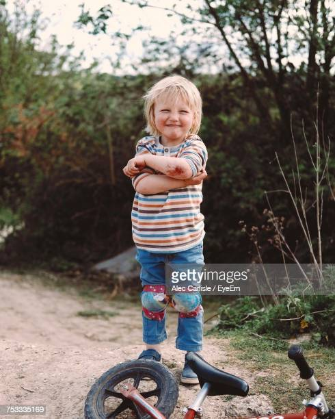portrait of crying boy showing injured elbow while standing by bicycle - wounded stock pictures, royalty-free photos & images