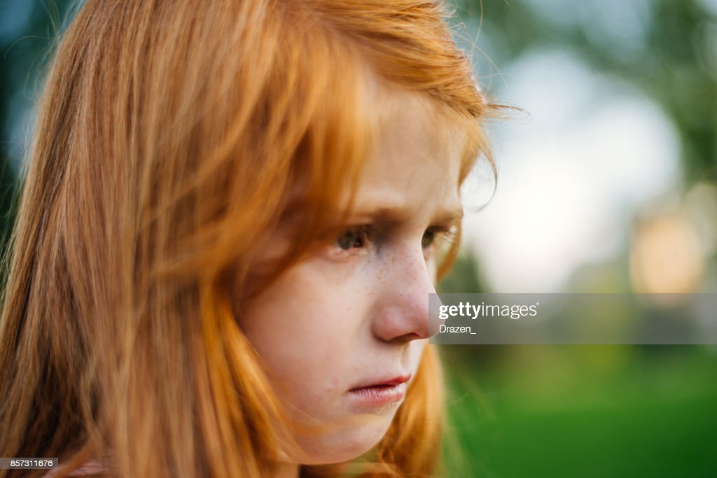 portrait of crying ginger girl stock photo | getty images