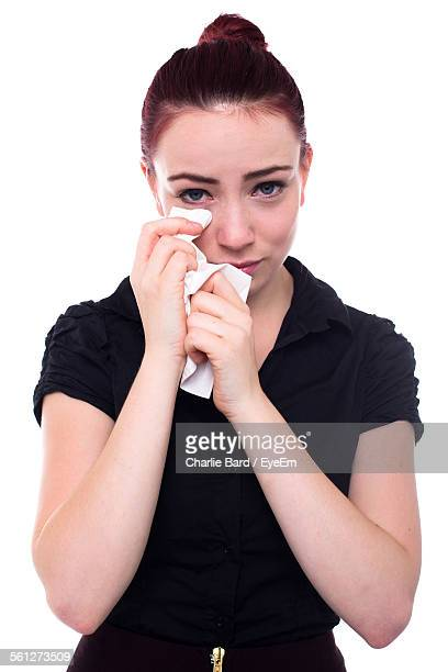 Portrait Of Crying Women Wiping Tears With Napkin
