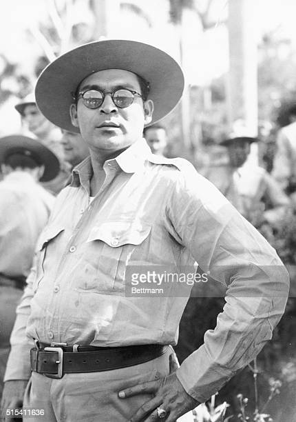 Portrait of Cuban soldier and dictator Fulgencio Batista standing in sunglasses and a widebrimmed hat in the field Fulgencio Batista suceeded in a...