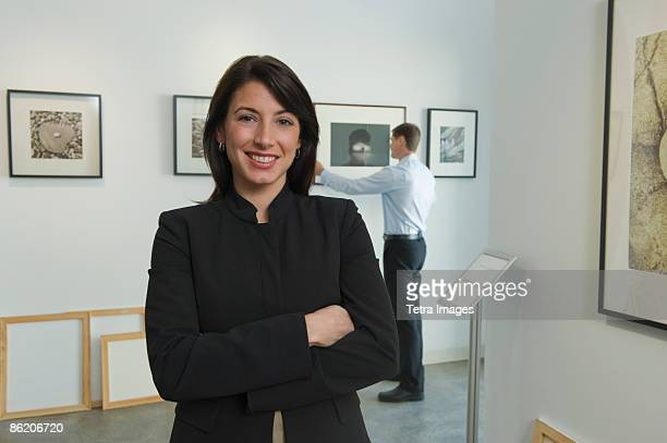 portrait of curator in art gallery - museum curator stock pictures, royalty-free photos & images