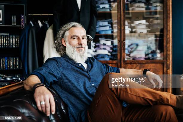 portrait of customer relaxing in menswear store - 40 44 jahre stock-fotos und bilder