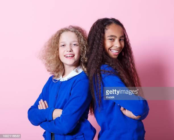 portrait of cute and happy multi ethnic schoolgirls - izusek stock pictures, royalty-free photos & images