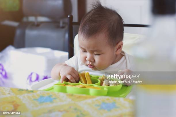 portrait of cute baby - unknown gender stock pictures, royalty-free photos & images