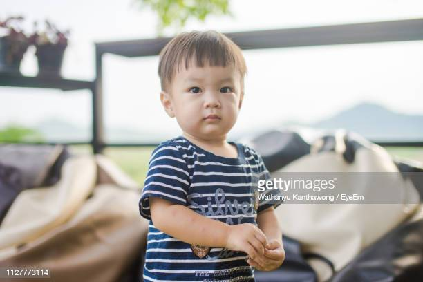 portrait of cute boy at home - at home ストックフォトと画像