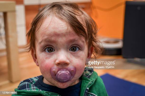 portrait of cute boy at home - morbillivirus stock pictures, royalty-free photos & images