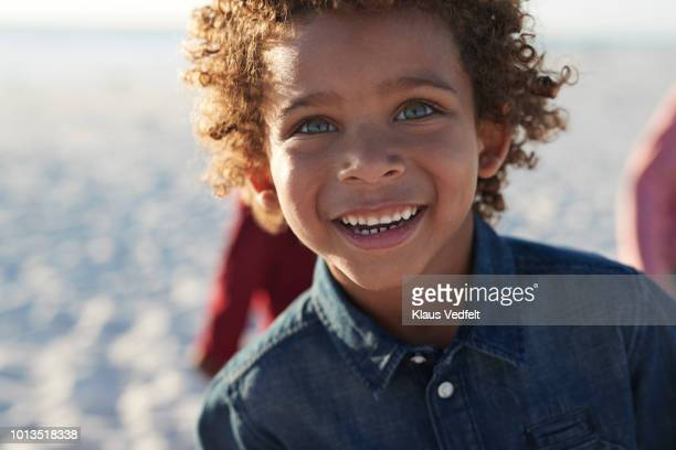 portrait of cute boy enjoying the beach - gray eyes stock pictures, royalty-free photos & images