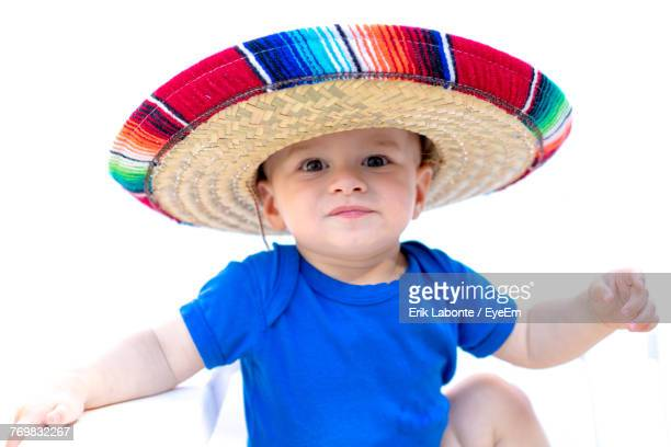 portrait of cute boy in multi colored hat - mexican hat stock pictures, royalty-free photos & images