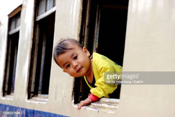 portrait of cute boy in train - ko ko htike aung stock pictures, royalty-free photos & images