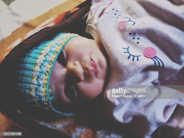 portrait of cute boy sleeping in bed - unknown gender stock pictures, royalty-free photos & images
