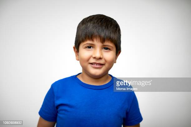 portrait of cute boy smiling on white background - small faces stock pictures, royalty-free photos & images