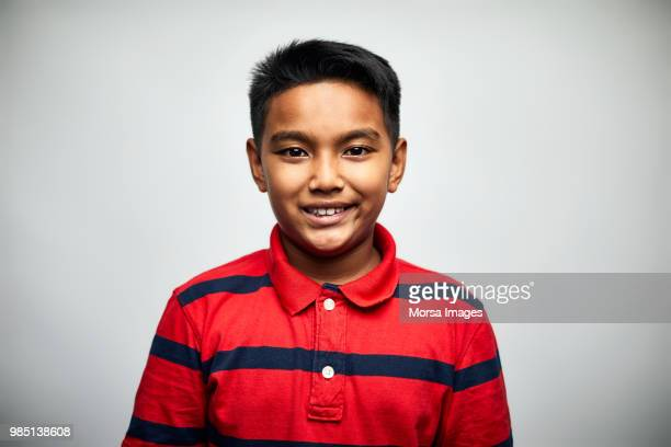 portrait of cute boy smiling on white background - meninos - fotografias e filmes do acervo