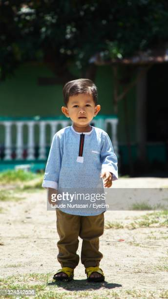 portrait of cute boy standing outdoors - unknown gender stock pictures, royalty-free photos & images
