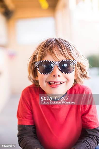 Portrait of cute boy wearing sunglasses