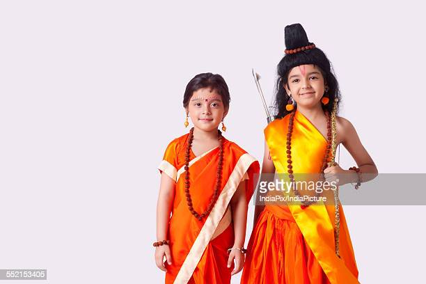 portrait of cute children dressed as ram and sita against white background - hindu god stock photos and pictures