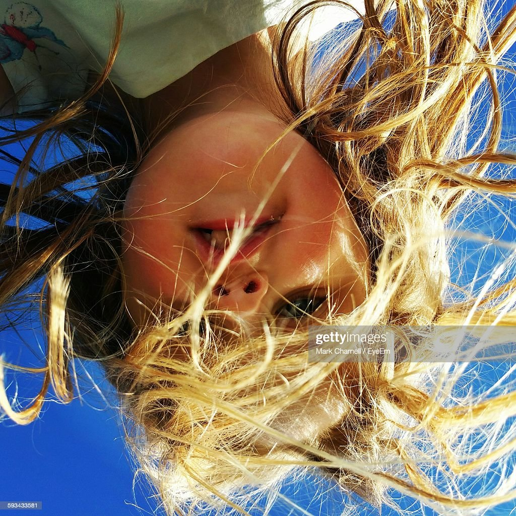 Portrait Of Cute Girl Against Clear Sky
