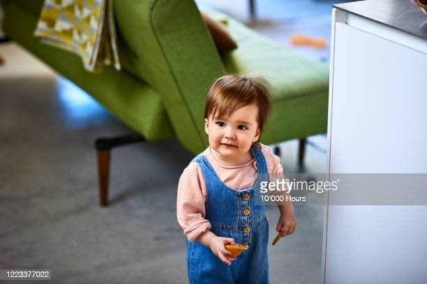 portrait of cute girl at home - toddler stock pictures, royalty-free photos & images