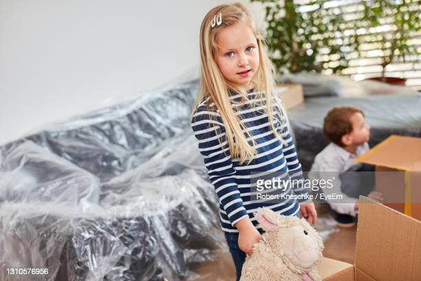 portrait of cute girl at home - mortgage stock pictures, royalty-free photos & images
