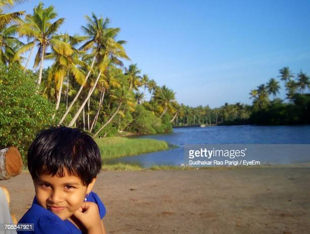 Portrait Of Cute Girl At Irangu Kadavu Against Clear Blue Sky