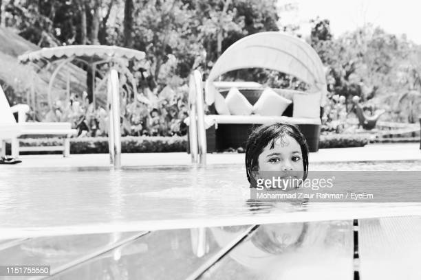 portrait of cute girl in swimming pool - ziaur rahman stock pictures, royalty-free photos & images