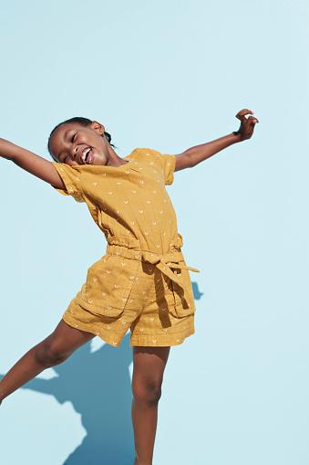Portrait of cute girl jumping cheerful - gettyimageskorea
