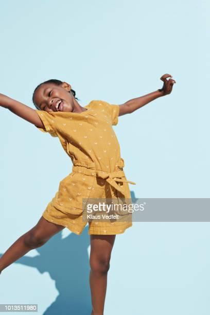 portrait of cute girl jumping cheerful - niñas fotografías e imágenes de stock