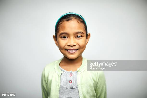 portrait of cute girl smiling on white background - raparigas imagens e fotografias de stock
