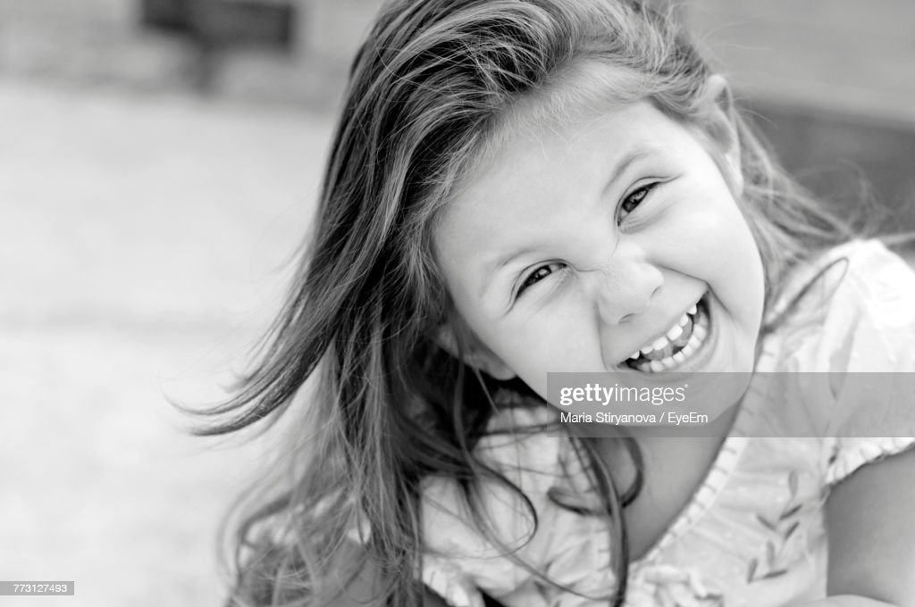 Portrait Of Cute Girl Smiling Outdoors : Photo