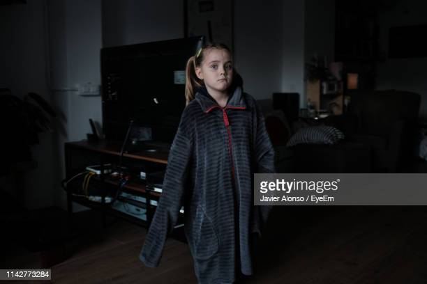portrait of cute girl standing at home - javier alonso fotografías e imágenes de stock