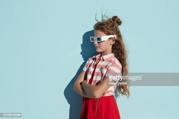portrait of cute girl wearing 3d glasses, on studio background - little girls up skirt fotografías e imágenes de stock