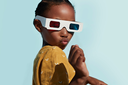 Portrait of cute girl wearing 3-D glasses while playing and posing - gettyimageskorea