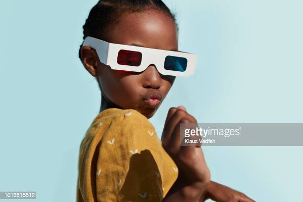 portrait of cute girl wearing 3-d glasses while playing and posing - man made stock pictures, royalty-free photos & images