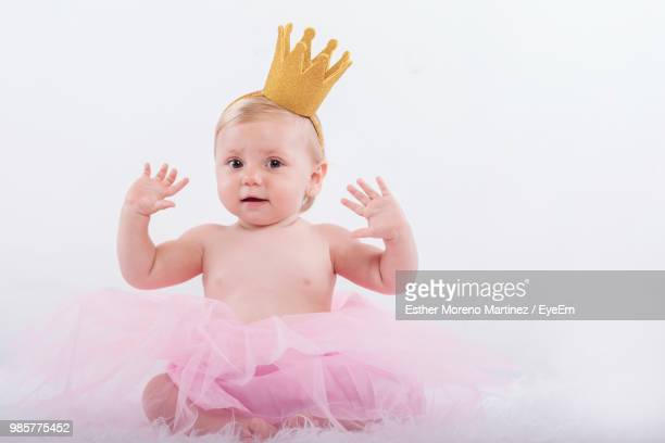 Portrait Of Cute Girl Wearing Costume Against White Background