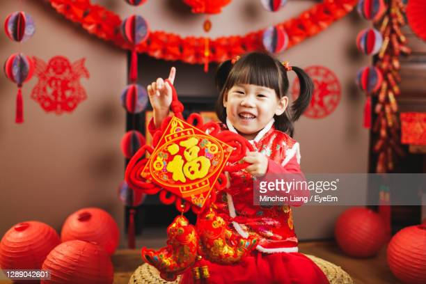 portrait of cute girl wearing costume holding box at home - fringe dress stock pictures, royalty-free photos & images