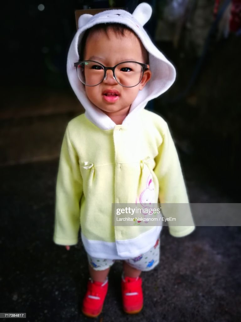 dc596d4f0d Portrait Of Cute Girl Wearing Eyeglasses Making Face While Standing On  Footpath : Stock Photo