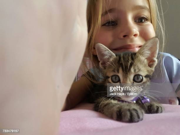 Portrait Of Cute Girl With Cat At Home